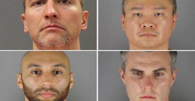 Que son los oficiales procesados por George Floyd de la muerte?