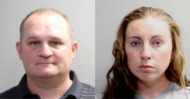 Blanco pareja arrestada después de que la pistola tira negra de la familia