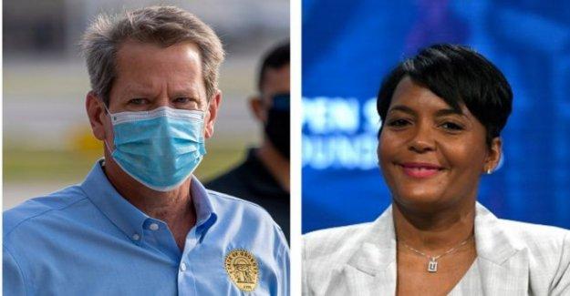El gobernador de Georgia, demanda de Atlanta sobre la cara de la máscara de reglas