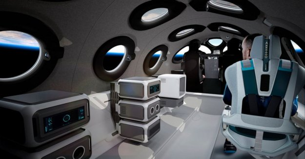 Virgin Galactic muestra de pasajeros de la nave espacial interior de la cabina de