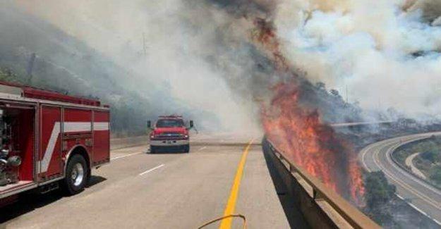 El calor mantas medio oeste, Noreste como la amenaza de 'rápido wildfire' se eleva hacia el Oeste