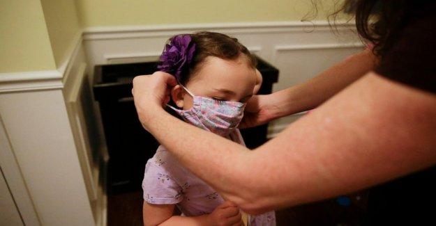 Los padres luchan como las escuelas abran en medio de la oleada de coronavirus