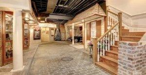 Maryland mansión para la venta viene con el pueblo de Navidad, con calles de adoquines en el sótano