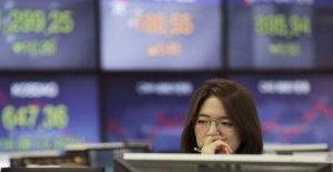Acciones asiáticas alza en el estímulo se mueve, los datos de los trabajos